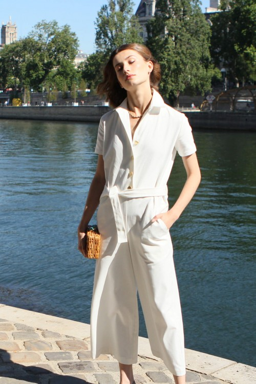 White jumpsuit with short sleeves and gold buttons 2