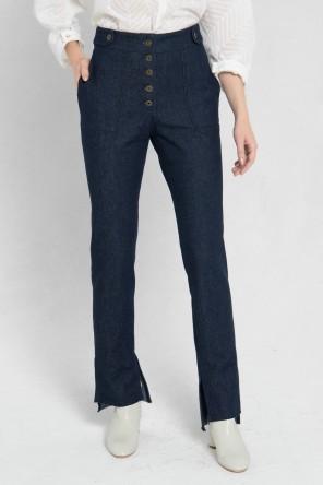 jeans brut avec boutons apparents et asymétrique en bas 1