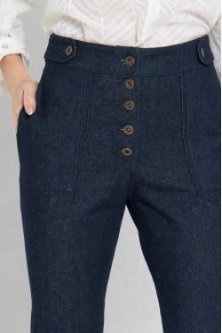 jeans brut avec boutons apparents et asymétrique en bas 2